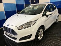 "USED 2017 17 FORD FIESTA 1.0 ZETEC 5d 99 BHP A wonderfull example of this family favorite 5 door hatchback finished in unmarked  frozen white complemented with 5 twin spoke 15"" alloy wheels ,this car comes with full service history ,still under manufacturers warranty untill March 2020 .This vehicle is equiped with all the usual zetec refinements including bluetooth phone preparation,dab radio cd player with usb , front fog lamps,start stop facilty . This car returns a combined ecconomy of 65.7mpg in conjunction with zero road tax."