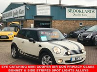 USED 2007 57 MINI HATCH COOPER 1.6 COOPER Pepper White with Anthracite  Cloth 118 BHP 6 Speed Manual Air Con Eye Catching Mini Cooper with Air Con Privacy Glass Bonnet & Side Stripes Spot Lights Alloys