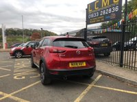 USED 2018 18 MAZDA CX-3 2.0 SPORT NAV 5d 118 BHP STUNNING FIRE RED METALLIC WITH FULL BLACK LEATHER WITH RED STITCHING. ONE OWNER WITH VERY LOW MILEAGE.SATELLITE NAVIGATION. REVERSE CAMERA. HEATED FRONT SEATS. CRUISE CONTROL. BOSE SOUND SYSTEM. ANTHRACITE ALLOY WHEELS. PLEASE GOTO www.lowcostmotorcompany.co.uk TO VIEW OVER 120 CARS IN STOCK