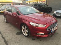 USED 2016 16 FORD MONDEO 2.0 TITANIUM HEV 4 DOOR HYBRID AUTOMATIC 187 BHP IN METALLIC RED WITH 62000 MILES AND A FULL SERVICE HISTORY. APPROVED CARS ARE PLEASED TO OFFER THIS FORD MONDEO 2.0 TITANIUM HEV 4 DOOR HYBRID AUTOMATIC 187 BHP IN METALLIC RED WITH A GREAT SPEC INCLUDING 2 Keys +, ABS, Active Parking Assist, Air conditioning, Alarm, Alloy wheels, Bluetooth, CD player, Central locking, Climate control, Cruise control, DAB Radio, Electric Folding Mirrors, Electric windows, Metallic paint, Parking Sensors (rear), Parking Sensors (front), Power steering, Rain sensing wipers, Rear Camera, Sat Nav and much more with a full fo