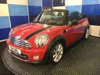 """USED 2011 11 MINI CONVERTIBLE 1.6 COOPER D 2d 112 BHP A stunning example of this family favorite finished in unmarked bright red with black bonet stripes and mirror backs further enhanced by 17"""" 8 spoke alloy wheels,this car has full main agent service history,looks and drives superbly,equiped with part leather trim ,digital climate control,rear parking sensors,dab radio with mini boost cd ,aux and usb imputs,heated front seats,onboard computer plus all the usual refinements,with road tax of only £20 a year and combined ecconomy of 70.6 mpg."""