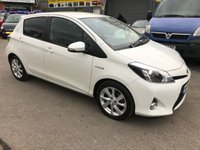 USED 2013 63 TOYOTA YARIS 1.5 T SPIRIT HYBRID 5d AUTO 75 BHP IN WHITE WITH ONLY 1 OWNER AND 17300 MILES IN IMMACULATE CONDITION. APPROVED CARS ARE PLEASED TO OFFER THIS TOYOTA YARIS 1.5 T SPIRIT HYBRID 5 DOOR AUTOMATIC 75 BHP IN WHITE WITH ONLY 1 OWNER AND ONLY 17300 MILES IN IMMACULATE CONDITION INSIDE AND OUT WITH A TOYOTA MAIN DEALER SERVICE HISTORY AN EXCELLENT HYBRID CAR WITH SAT NAV AND EVERYTHING YOU NEED.