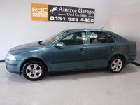 USED 2008 58 SKODA OCTAVIA 1.6 AMBIENTE FSI 5d 114 BHP AMAZING CAR WITH SERVICE HISTORY , FININISHED IN GLEAMING METALLIC GREEN WITH,  18 INCH ALLOYS, LEATHER CLAD MULTI FUNCTION STEERING WHEEL, MOBIL SAT NAV,   REAR PARKING SENSORS, AUTO HEAD LAMPS, BLUETOOTH PHONE PREP , TOUCH SCREEN RADIO CD