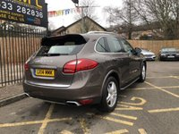 "USED 2014 14 PORSCHE CAYENNE 4.1 D V8 S TIPTRONIC S 5d AUTO 382 BHP STUNNING UMBER METALLIC WITH FULL ESPRESSO/COGNAC FULL NATURAL LEATHER UPHOLSTERY. ONLY ONE OWNER FROM NEW. FULL PORSCHE SERVICE HISTORY. NEW MOT ON PURCHASE. 19"" CAYENNE TURBO ALLOY WHEELS. PCM TOUCH SCREEN SATELLITE NAVIGATION SYSTEM. BLUETOOTH WITH TELEPHONE MODULE. MULTI FUNCTION STEERING WHEEL. ALUMINIUM LOOK ROOF RAILS. WHEEL ARCH EXTENSION BODY COLOUR. POWERLIFT TAILGATE. PARK ASSIST FRONT AND REAR. HEATED FRONT SEATS. LIGHT COMFORT PACKAGE. BOSE SURROUND SOUND SYSTEM. DAB RADIO. 100 LITR"
