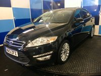 "USED 2013 13 FORD MONDEO 2.0 ZETEC BUSINESS EDITION TDCI 5d AUTO 161 BHP A very clean example of this highly sought after family diesel auto finished in unmarked panther black metalic enhanced by 17"" 15 spoke alloy wheels this car comes fully loaded with satelite navigation,bluetooth phone preparation ,voice control system,cruise control/ speed limiter,digital climate control ,front and rear parking sensors plus all the usual refinements.This car looks and drives superbly returning a very impressive combined ecconomy of just over 50 mpg,definitely one to concider."