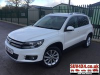 USED 2011 61 VOLKSWAGEN TIGUAN 2.0 SE TDI BLUEMOTION TECHNOLOGY 4MOTION 5d 138 BHP STOP/START PRIVACY FSH 4WD. STOP/START. PARK ASSIST. STUNNING WHITE WITH BLACK CLOTH TRIM. 17 INCH ALLOYS. COLOUR CODED TRIMS. PRIVACY GLASS. PARKING SENSORS. BLUETOOTH PREP. DUAL CLIMATE CONTROL. MEDIA CONNECTIVITY. MFSW. 6 SPEED MANUAL. ROOF BARS. MOT 09/19. FULL SERVICE HISTORY. SUV & 4X4 CAR CENTRE LS23 7FR. TEL 01937 849492. OPTION 2