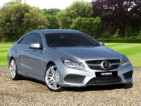 "USED 2014 64 MERCEDES-BENZ E-CLASS 2.1 E220 CDI AMG SPORT 2d AUTO 170 BHP We Are Delighted To Offer You This Great  Mercedes E220 AMG Sport. This Car Comes With Loads Of Features Including: 19"" AMG Spoked Wheels, Diamond Silver Metallic Paint, AMG Styling Package, Front Spoiler, Side Skirt, AMG Sports Package, Sports Suspension, Command DVD with Navigation, DAB Radio, Front Heated Seats, Full Black Leather, Active Park Assist, Interior and Exterior Auto Dimming Mirrors, Sports Steering Wheel, Steering Wheel Gearshift With Paddle Shift and there are loads more........"