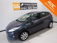 USED 2011 11 FORD FIESTA 1.4 ZETEC 16V 5d 96 BHP FANTASTIC CAR AND WELL LOOKED AFTER, FULL SERVICE HISTORY 8 STAMPS, GLEAMING METALLIC GRAY ,  ALLOY WHEELS. CHROME FRONT HEADLIGHTS AND TINTED GLASS. DAB RADIO CD WITH USB AUX, BLUETOOTH PHONE PREP, LEATHER TRIMMED HANDBRAKE AND STEERING WHEEL