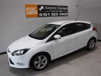 USED 2014 14 FORD FOCUS 1.6 ZETEC NAVIGATOR ECONETIC TDCI START/STOP 5d 104 BHP AMAZING CAR IN  WONDERFUL WHITE, ONE OWNER WITH FULL SERVICE HISTORY  IT LOOKS AND DRIVES LIKE NEW, THE CAR HAS UPGRADED ALLOYS, SAT NAV,  PARKING SENSORS,  FRONT FOG LAMPS, LEATHER CLAD MULTI FUNCTION STEERING WHEEL,BLUETOOTH PHONE AND AUDIO PREP, ELEC WINDOWS, ELEC MIRRORS,DAB RADIO CD PLAYER,VERY ECONOMICAL, LOW TAX, AIR CON,