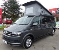 USED 2018 18 VOLKSWAGEN TRANSPORTER T30 TDI CAMPER VAN LWB DSG (AUTO) GEARBOX 150 BLUEMOTION EURO 6 Extras Include:Air Conditioning - Cruise -  Leather Steering Wheel - Power latch side door -  Full pop top roof with adult rated upper bed system - RIB Altair crash tested 3 seater bed - Swivelling front passenger seat - Sink integrated into worktop - Full size oven with 3 hob rings - 20 litre drawer fridge - Individual coffee tables -  Internal touch LED lighting system - Power management system 12v and 240v - Water gauge and battery level indicators - Auxiliary 12v fuse board for future upgrad