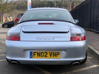 "USED 2002 02 PORSCHE 911 3.6 CARRERA 4 2d 316 BHP STUNNING POLAR SILVER METALLIC WITH LUXURY METROPOL BLUE LEATHER UPHOLSTERY. 18"" CARRERA ALLOY WHEELS. BOSE SOUND SYSTEM. TOUCH SCREEN SATELLITE NAVIGATION SYSTEM. GREEN WINDOWS TINT. BIG FOLDER FULL OF RECEIPTS. COLOUR CODED HARD TOP INCLUDED. ELECTRIC HOOD. STUNNING EXAMPLE. PLEASE GOTO www.lowcostmotorcompany.co.uk TO VIEW OVER 120 CARS IN STOCK, SOME OF THE CHEAPEST ON THE WEB"
