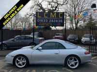 """USED 2002 02 PORSCHE 911 3.6 CARRERA 4 2d 316 BHP STUNNING POLAR SILVER METALLIC WITH LUXURY METROPOL BLUE LEATHER UPHOLSTERY. 18"""" CARRERA ALLOY WHEELS. BOSE SOUND SYSTEM. TOUCH SCREEN SATELLITE NAVIGATION SYSTEM. GREEN WINDOWS TINT. BIG FOLDER FULL OF RECEIPTS. COLOUR CODED HARD TOP INCLUDED. ELECTRIC HOOD. STUNNING EXAMPLE. PLEASE GOTO www.lowcostmotorcompany.co.uk TO VIEW OVER 120 CARS IN STOCK, SOME OF THE CHEAPEST ON THE WEB"""