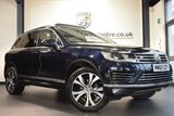 """USED 2015 65 VOLKSWAGEN TOUAREG 3.0 V6 R-LINE TDI BLUEMOTION TECHNOLOGY 5DR AUTO 259 BHP full vw service history FINISHED IN STUNNING MOONLIGHT METALLIC BLUE WITH FULL LEATHER INTERIOR + FULL VW SERVICE HISTORY + SATELLITE NAVIGATION + PANORAMIC ROOF + BLUETOOTH + HEATED SEATS + HEATED STEERING WHEEL + DAB RADIO + CRUISE CONTROL + ELECTRIC FOLDING MIRRORS + PARKING SENSORS + 20"""" ALLOY WHEELS"""