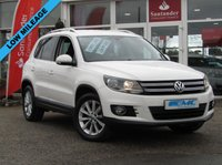 USED 2013 13 VOLKSWAGEN TIGUAN 2.0 SE TSI 4MOTION 5d 178 BHP STUNNING, RARE 4X4, VOLKSWAGEN TIGUAN 2.0 SE TSI 4 MOTION, 178 BHP. Finished in CANDY WHITE with contrasting CLOTH/ALCANTARA trim. This Rare 2.0 TFSI petrol Tiguan has a more sophisticated look to add to its high quality interior and high spec. In short this Tiguan is spacious, comfortable and great to drive, while its raised driving position gives you a great view. Comes with 12 months MOT