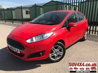 USED 2013 63 FORD FIESTA 1.0 ZETEC 5d 99 BHP  STUNNING RED MET WITH BLACK CLOTH TRIM. 15 INCH ALLOY WHEELS. COLOUR CODED TRIMS. BLUETOOTH PREP. AIR CON. R/CD PLAYER. MFSW. MOT 12/19. P/X CLEARANCE CENTRE LS23 7FQ TEL 01937 849492 OPTION 4