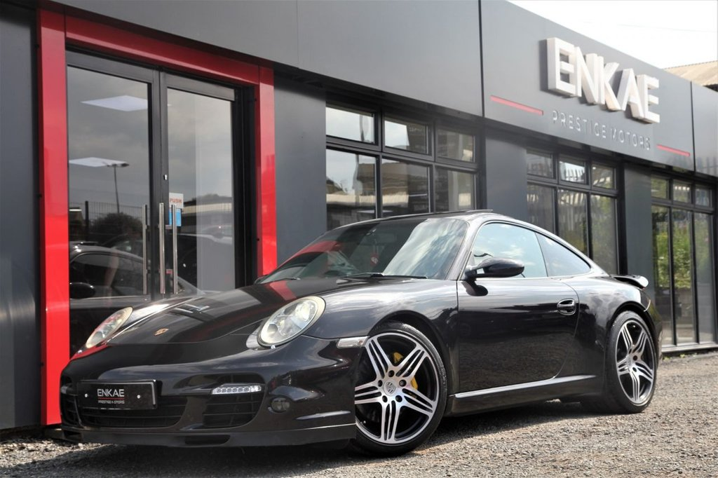 "USED 2005 05 PORSCHE 911 3.8 CARRERA 2 TIPTRONIC S 2d AUTO VERY RARE CAR TURBO LOOKS*MILLTEK EXHAUST*SAT NAV*SUN ROOF*19"" ALLOYS*TURBO ALLOYS*TURBO BUMPER*GENERATION II REAR LIGHTS*ALCANTARA ROOF LININGS*ELECTRIC SEATS*LOWERED ON EIBACH SPRINGS*ABSOLUTELY AMAZING CAR"