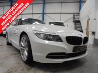 "USED 2011 61 BMW Z4 2.5 Z4 SDRIVE23I HIGHLINE EDITION 2d 201 BHP Comprehensive Service History, Heated Coral Leather Seats, Bluetooth Hands Free, Auto Lights and Wipers, Height Adjust Front Seats, Xenons with Halo Surrounds and Wash, Remote Locking with 2 Keys, 19"" Alloys"