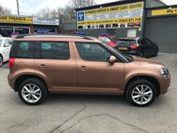 USED 2014 14 SKODA YETI 1.2 SE TSI DSG 5 DOOR AUTOMATIC 103 BHP IN METALLIC BRONZE WITH ONLY 24,000 MILES APPROVED CARS AND FINANCE ARE PLEASED TO OFFER THIS SKODA YETI 1.2 SE TSI DSG 5 DOOR AUTO 103 BHP IN METALLIC BRONZE WITH ONLY 24,000 MILES ON THE CLOCK AND A FULL SERVICE HISTORY, THIS VEHICLE HAS GOT A GREAT SPEC SUCH AS FULLY AUTOMATIC GEARBOX, AIR CON, ALLOY WHEELS, PARKING SENSORS (REAR) AND MUCH MORE. THIS IS A PERFECT  FAMILY VEHICLE DUE TO THE SIZE AND VERY ECONOMICAL A LOW ROAD TAX.