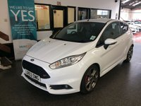 "USED 2013 63 FORD FIESTA 1.6 ST-2 3d 180 BHP Only 16065 miles from new and one private owner! This Fiesta ST-2 Turbo is finished in frozen white with Black cloth and part leather Recaro Heated seats. It is fitted with power steering, remote locking, electric windows and power folding mirrors, climatic air conditioning, heated front screen, Bluetooth, grey 17"" alloy wheels with red brake calipers, Tinted glass, DAB/USB/Aux CD Stereo, Illuminated door inserts in red and more. It comes with a complete service history from Ford."