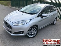 USED 2013 63 FORD FIESTA 1.0 TITANIUM 5d 124 BHP AIR CON ALLOYS CRUISE BLUETOOTH STUNNING SILVER MET WITH BLACK CLOTH TRIM. CRUISE CONTROL. 16 INCH ALLOYS. COLOUR CODED TRIMS. PRIVACY GLASS. PARKING SENSORS. BLUETOOTH PREP. CLIMATE CONTROL WITH AIR CON. R/CD PLAYER. MFSW. MOT 11/19. SERVICE HISTORY. P/X CLEARANCE CENTRE LS23 7FQ TEL 01937 849492 OPTION 4