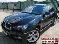 USED 2010 10 BMW X6 XDRIVE 3.0D AUTO SAT NAV LEATHER  4WD. SATELLITE NAVIGATION. STUNNING BLACK MET WITH FULL BEIGE LEATHER TRIM. ELECTRIC HEATED MEMORY SEATS. CRUISE CONTROL. 20 INCH ALLOYS. SIDE STEPS. COLOUR CODED TRIMS. PARKING SENSORS. BLUETOOTH PREP. DUAL CLIMATE CONTROL INCLUDING AIR CON. R/CD PLAYER. MFSW. MOT 12/19. SERVICE HISTORY. PRESTIGE SUV CENTRE - LS24 8EJ. TEL 01937 849492 OPTION 1