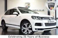USED 2014 14 VOLKSWAGEN TOUAREG 3.0 V6 R-LINE TDI BLUEMOTION TECHNOLOGY 5DR 242 BHP full service history FINISHED IN STUNNING PURE WHITE FULL BLACK LEATHER INTERIOR + FULL SERVICE HISTORY + SATELLITE NAVIGATION + BLUETOOTH + HEATED SPORT SEATS + FULL PANORAMIC ROOF + DAB RADIO + HEATED STERRING WHEEL + CRUISE CONTROL + HEATED ELECTRIC FOLDING MIRRORS + PARKING SENSORS + 20 INCH ALLOY WHEELS