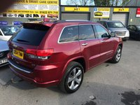 USED 2014 14 JEEP GRAND CHEROKEE 3.0 V6 CRD OVERLAND 5d AUTO 247 BHP IN METALLIC RED WITH A HUGH SPEC AND 87000 MILES WITH  A FULL SERVICE HISTORY. APPROVED CARS ARE PLEASED TO OFFER THIS JEEP GRAND CHEROKEE 3.0 V6 CRD OVERLAND 5 DOOR AUTO 247 BHP IN METALLIC RED WITH A HUGH SPEC INCLUDING ABS, Power steering, Air conditioning, Electric seats, Privacy glass, Alarm, Electric windows, Rain sensing wipers, Alloy wheels, Sat Nav, Bluetooth, Heated seats, Headlights - washers, Electric Sunroof, CD player, Towbar, (Full) Leather , Xenon Headlights, Central locking, Metallic paint, Climate control, Panoramic roof, Cruise control, Parking Sensors (