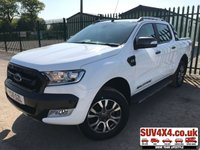 USED 2016 16 FORD RANGER 3.2 WILDTRAK 4X4 DCB TDCI 1d 197 BHP LOW MILEAGE SAT NAV LEATHER (COMMERCIAL £18400 + 3680 VAT). SATELLITE NAVIGATION. STUNNING WHITE WITH FULL BLACK AND ORANGE WILDTRACK LEATHER TRIM. ELECTRIC HEATED SEATS. CRUISE CONTROL. SIDE STEPS. CLIMATE CONTROL WITH AIR CON. 18 INCH ALLOYS. COLOUR CODED TRIMS. PRIVACY GLASS. PARKING SENSORS. REVERSING CAMERA. CARGO LINING. BLUETOOTH PREP. PAS. R/CD PLAYER. 6 SPEED MANUAL. MFSW. ROOF BARS. MOT 02/20. SERVICE HISTORY. PRESTIGE SUV CENTRE LS24 8EJ TEL 01937 849492 OPTION 1