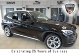 USED 2014 63 BMW X1 2.0 XDRIVE18D XLINE 5d 141 BHP FINISHED IN STUNNING BLACK WITH FULL BLACK LEATHER SEATS + EXCELLENT BMW SERVICE HISTORY + BLUETOOTH + DAB RADIO + REAR PARKING SENSORS + 18 INCH ALLOYS + HEATED FRONT SEATS + X-LINE + SPORTS STEERING WHEEL
