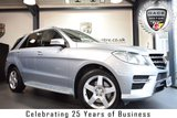 """USED 2014 14 MERCEDES-BENZ M CLASS 3.0 ML350 BLUETEC AMG SPORT 5DR 258 BHP FINISHED IN STUNNING DIAMOND METALLIC SILVER WITH HALF LEATHER INTERIOR + SATELLITE NAVIGATION + BLUETOOTH + AMG STYLING PACKAGE-FRONT SPOILER, SIDE SKIRT + CRUISE CONTROL + ELECTRIC ADJUSTABLE SEATS + ACTIVE PARK ASSIST + 19"""" ALLOY WHEELS"""