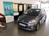 USED 2014 14 HYUNDAI I10 1.0 PREMIUM 5d 65 BHP This i10 is finished in Metallic Stardust grey with Black/Blue cloth seats. It is fitted with power steering, Bluetooth, remote locking, electric windows and mirrors, air conditioning, cruise control, wheel trims, CD Stereo with Aux & USB port and more. It has had one lady owner from new and comes with a service history consisting of 4 stamps, 3 Hyundai And one independent. The current Mot runs till June. We will supply the car with its 5th service, 12 months MOT and 6 months RAC Warranty.