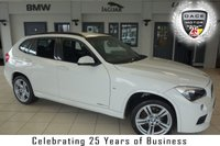 "USED 2013 63 BMW X1 2.0 XDRIVE20D M SPORT 5d AUTO 181 BHP FINISHED IN STUNNING ALPINE WHITE WITH FULL BLACK LEATHER SPORTS SEATS + FULL SERVICE HISTORY + BUSINESS NAVIGATION SYSTEM + DAB RADIO + BLUETOOTH + CRUISE CONTROL + AUTOMATIC AIR CONDITIONING + MULTIFUNCTION STEERING WHEEL + 18"" ALLOY WHEELS"