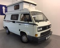 """USED 1989 VOLKSWAGEN TRANSPORTER 1.9 CARAVAN 1d  Stunning Volkswagen T25 Holdsworth """"Villa 3"""" Hi Top Camper Van Finished in Gleaming Pastel White With Contrasting 1990's Retro Body Striping And Beige Draylon Upholstery, Just 70,250 Miles With Only 2 Owners From New, Massive Service File That Includes The Original Service Book With 15 Stamps Up Till 2009 And Then A Huge File That Includes All The Bills For The Last 10 Years And Even The Original Bill Of Sale, In Really Very, Very Good Original Order Throughout"""