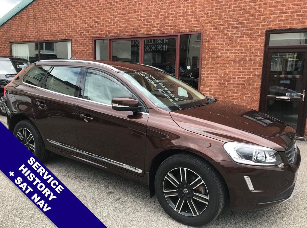 """USED 2015 65 VOLVO XC60 2.4 D5 SE LUX NAV AWD 5DOOR 217 BHP DAB      :      Sat Nav      :      USB & AUX      :      Auto Headlights      :      Car Hotspot / WiFi      Cruise Control      :      Bluetooth      :      Heated Front Seats      :      Electric Front Seats      Full Beige Leather Upholstery         :         Automatic Tailgate         :         Rear Parking Sensors       18"""" Alloy Wheels   :   Service History"""