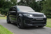 USED 2015 65 LAND ROVER RANGE ROVER SPORT SVR 5.0 V8 SVR 5d AUTO 503 BHP A High Spec SVR with Supercar Performance and an Extensive List of Desirable Features. Presented in Santorini Black with 22 Inch Gloss Black Style 6 Alloy Wheels and a Luxury Ebony / Cirrus Leather Interior, Heated Sports Seats with Memory Function, Sliding Panoramic Glass Sunroof, HDD Satellite Navigation, Bluetooth Connectivity, Meridian Premium Surround Sound, DAB Radio, Remote Power Handsfree Tailgate, Front and Rear Park Distance Control with Reversing Camera, Adaptive Cruise Control...