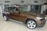 USED 2014 63 BMW X1 2.0 XDRIVE18D XLINE 5d 141 BHP FINISHED IN STUNNING MARRAKECH BROWN WITH FULL OYSTER CREAM LEATHER SEATS + EXCELLENT BMW SERVICE HISTORY + BLUETOOTH + 18 INCH ALLOYS + HEATED FRONT SEATS + DAB RADIO + REAR PARKING SENSORS + AIR CONDITIONING