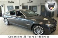 USED 2012 BMW 7 SERIES 3.0 730D SE 4d 242 BHP FINISHED IN STUNNING GREY WITH FULL BLACK LEATHER SEATS + SERVICE HISTORY + SATELLITE NAVIGATION + DAB RADIO + BLUETOOTH + AIR CONDITIONING + ALLOY WHEELS