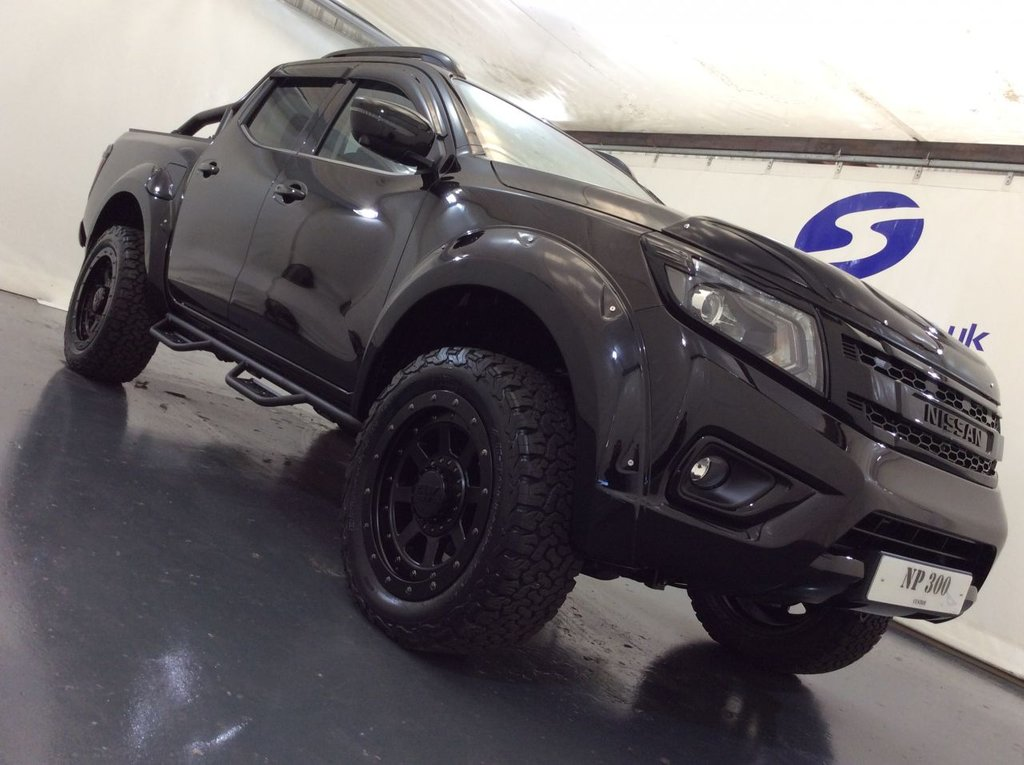 """USED 2019 19 NISSAN NP300 NAVARA 2.3 DCI TEKNA DOUBLE CAB 4d AUTO 190 BHP CUSTOM STYLED EXCLUSIVE 20"""" CUSTOM WHEELS NO SPACERS FITTED WITH BF GOODRICH ALL TERRAIN TYRES, SUSPENSION LIFT KIT, INDIVIDUAL BODY STYLING INCLUDING WHEEL ARCH, EXTENSIONS BLACK LIGHT GUARDS FRONT AND REAR, SIDE NERF BARS, BLACK ROLLER SHUTTER WITH BLACK OVER BAR, SMOKED BONNET AND WINDOW DEFLECTORS DECHROMED, HEAVY DUTY LINER SATELLITE NAVIGATION, ELECTRIC SUNROOF, 360 CAMERA, FULL BLACK LEATHER WITH WHITE CONTRAST STITCH, ELECTRIC DRIVERS SEAT, CRUISE CONTROL, TRACTION CONTROL, AUTOMATIC LIGHTS AND WIPERS"""