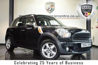 """USED 2012 62 MINI COUNTRYMAN 1.6 ONE 5DR 98 BHP * NO ADMIN FEES * FINISHED IN STUNNING ABSOLUTE METALIIC BLACK WITH CARBON CLOTH UPHOLSTERY + BLUETOOTH + DAB RADIO + LIGHT PACKAGE + AUTO AIR CON + PARKING SENSORS + 16"""" ALLOY WHEELS"""