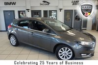 USED 2015 15 FORD FOCUS 1.0 TITANIUM 5d 124 BHP FINISHED IN STUNNING GREY WITH GREY CLOTH SPORT SEATS + FULL FORD SERVICE HISTORY + SATELLITE NAVIGATION + BLUETOOTH + £20 ROAD TAX + 17 INCH ALLOYS + DAB RADIO + LED DAYTIME LIGHTS + QUICKCLEAR WINDSCREEN + AIR CONDITIONING
