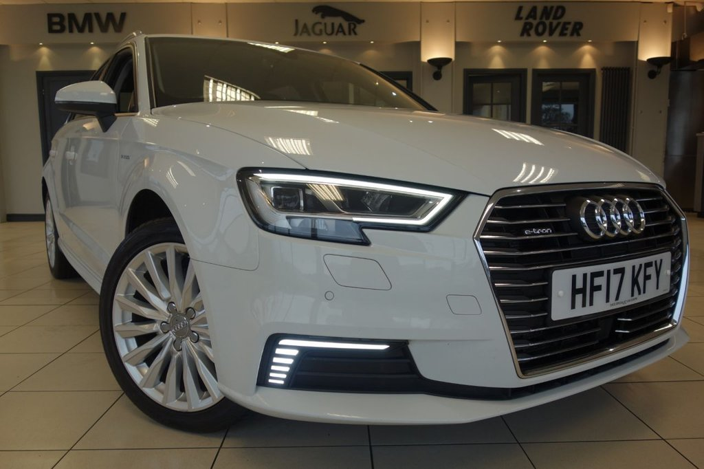 USED 2017 17 AUDI A3 1.4 SPORTBACK E-TRON 5d AUTO 101 BHP FINISHED IN STUNNING OPTIC WHITE WITH HALF LEATHER HALF ALCANTARA HEATED SEATS + FULL AUDI SERVICE HISTORY + SATELLITE NAVIGATION + COMFORT ACCESS + WIRELESS CHARGE PORT (CHARGE YOUR PHONE BY LAYING IT ON THE PAD) + DAB DIGITAL RADIO + BLUETOOTH PHONE AND MEDIA + ADAPTIVE CRUISE CONTROL + CLIMATE CONTROLLEDAIR CONDITIONING + FRONT AND REAR PARKING SENSORS WITH PARK ASSIST + 17 INCH UNMARKED ALLOY WHEELS + HEATED MIRRORS + PADDLESHIFT GEARS + BLINDSPOT ASSIST