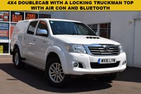 USED 2016 16 TOYOTA HI-LUX 2.5 ICON 4X4 D-4D DCB 1d 142 BHP A 2016 Toyota Hi Lux 2.5d4d DOUBLE CAB ICON 4X4 in white with a locking top box.