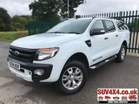 USED 2014 64 FORD RANGER 3.2 WILDTRAK 4X4 DCB TDCI 1d AUTO 197 BHP SAT NAV LEATHER REAR CANOPY  (COMMERCIAL £13900+2780 VAT). TRUCK MAN REAR CANOPY. STUNNING WHITE WITH FULL BLACK AND ORANGE WILDTRACK LEATHER TRIM. ELECTRIC HEATED SEATS. CRUISE CONTROL. SIDE STEPS. CLIMATE CONTROL WITH AIR CON. 18 INCH ALLOYS. COLOUR CODED TRIMS. PRIVACY GLASS. PARKING SENSORS. CARGO LINING. BLUETOOTH PREP. PAS. R/CD PLAYER. MFSW. ROOF BARS. TOWBAR. MOT 07/20. SERVICE HISTORY. PRESTIGE SUV CENTRE LS24 8EJ TEL 01937 849492 OPTION 1