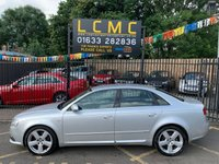 "USED 2006 56 AUDI A4 3.0 TDI QUATTRO DPF S LINE 4d AUTO 229 BHP STUNNING PLATINUM SILVER METALLIC WITH TWO TONE BLACK/GREY LEATHER. ONLY FOUR OWNERS FROM NEW. NEW MOT ON PURCHASE. BOSE SOUND SYSTEM. 18"" ALLOY WHEELS. REAR PARKING SENSORS. SATELLITE NAVIGATION (NEEDS DISK). AIR CONDITIONING. ELECTRIC WINDOWS. REMOTE CENTRAL LOCKING WITH TWO KEYS. PLEASE GOTO www.lowcostmotorcompany.co.uk TO VIEW OVER 120 CARS IN STOCK"