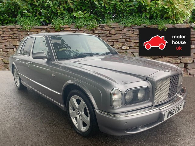 USED 2000 W BENTLEY ARNAGE 6.8 RED LABEL 4d AUTO 401 BHP VERY LOW MILEAGE STUNNING WELL MAINTAINED LOW MILEAGE EXAMPLE WITH FULL AND TOTAL DOCUMENTED SERVICE HISTORY (9 STAMPS). STUNNING COLOUR COMBINATION IN A1 CONDITION THROUGHOUT ALLOY WHEELS. PARK SENSORS. HEATED LEATHER SEATS. RADIO/CD. CRUISE CONTROL. CLIMATE CONTROL.19 INCH ALLOYS, ELECTRIC HEATED SEATS, SPORT MODE, FACTORY FITTED BENTLEY SAT NAV AT AN ADDITIONAL COST OF CIRCA £4000