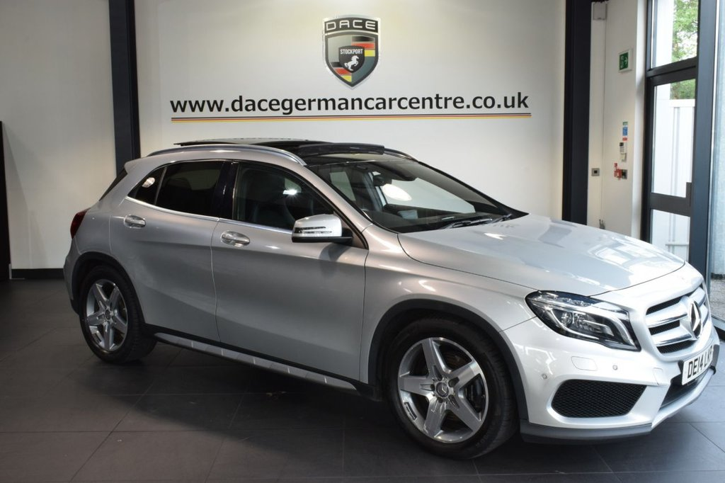 """USED 2014 14 MERCEDES-BENZ GLA-CLASS 2.1 GLA220 CDI 4MATIC AMG LINE PREMIUM PLUS 5DR AUTO 168 BHP excellent service history * NO ADMIN FEES * FINISHED IN STUNNING POLAR METALLIC SILVER WITH HALF BLACK LEATHER INTERIOR + EXCELLENT SERVICE HISTORY + SATELLITE NAVIGATION + BLUETOOTH + PANORAMIC SUNROOF + HEATED SEATS + REAR-VIEW CAMERA + AMG STYLING PACKAGE-FRONT SPOILER, SIDE SKIRT + ATTENTION ASSIST (DROWSINESS DETECTION) + DAB RADIO + ELECTRIC FOLDING MIRRORS + ACTIVE PARK ASSIST + 18"""" AMG SPOKE ALLOY WHEELS"""