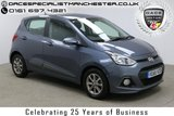 "USED 2015 65 HYUNDAI I10 1.2 PREMIUM 5d 86 BHP Finished in stunning Grey Metallic with Black/Blue Cloth Upholstery, 14"" Alloy Wheels, 1 Owner and Full Service History. Bluetooth, LED Daytime Running Lights, Air Con, Electric Mirrors and Windows"