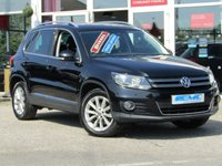 USED 2013 13 VOLKSWAGEN TIGUAN 2.0 SE TDI BLUEMOTION TECHNOLOGY 5d 138 BHP Stunning, VW Tiguan 2.0 SE TDI Bluemotion Technology 138 BHP. Finished in DEEP BLACK PEARL MET with contrasting Black ALCANTARA/Cloth interior. The Deep Black Pearl finish gives this Tiguan a more sophisticated look to add to its high quality interior and high spec. In short this Tiguan is spacious, comfortable and great to drive, while its raised driving position gives you a great view. Features include Auto Parking, DAB, Alloys, Cruise, B/Tooth and much more.