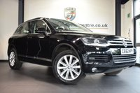 "USED 2012 62 VOLKSWAGEN TOUAREG 3.0 V6 SE TDI BLUEMOTION TECHNOLOGY 5DR AUTO 242 BHP full service history *NO ADMIN FEES* FINISHED IN STUNNING BLACK WITH FULL BLACK LEATHER INTERIOR + FULL SERVICE HISTORY + SATELLITE NAVIGATION + BLUETOOTH + DAB RADIO + HEATED SPORT SEATS + CRUISE CONTROL + HEATED ELECTRIC FOLDING MIRRORS + PARKING SENSORS  + 19"" ALLOY WHEELS"