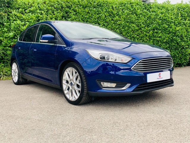 """USED 2015 15 FORD FOCUS 1.5 TITANIUM X TDCI 5d 118 BHP One Owner From New, Full Service History, Heated Front Seats, Sat Nav, Bluetooth, 18"""" Alloy Wheels, Climate Control, Air Conditioning, Finished In Deep Impact Blue Metallic Paintwork, Cruise Control, Front + Rear Parking Sensors, Excellent Fuel Economy, Spare Key, Drive Away In Under 1 Hour"""